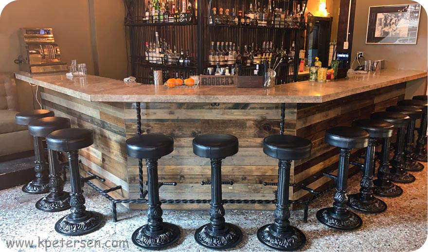 Bar Front With Ornate Cast Iron Round Bottom Pub Stools