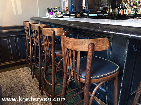 Steam Bent Wood Bistro Bar Stool Nail Trimmed Upholstered Seat Installation Rear View